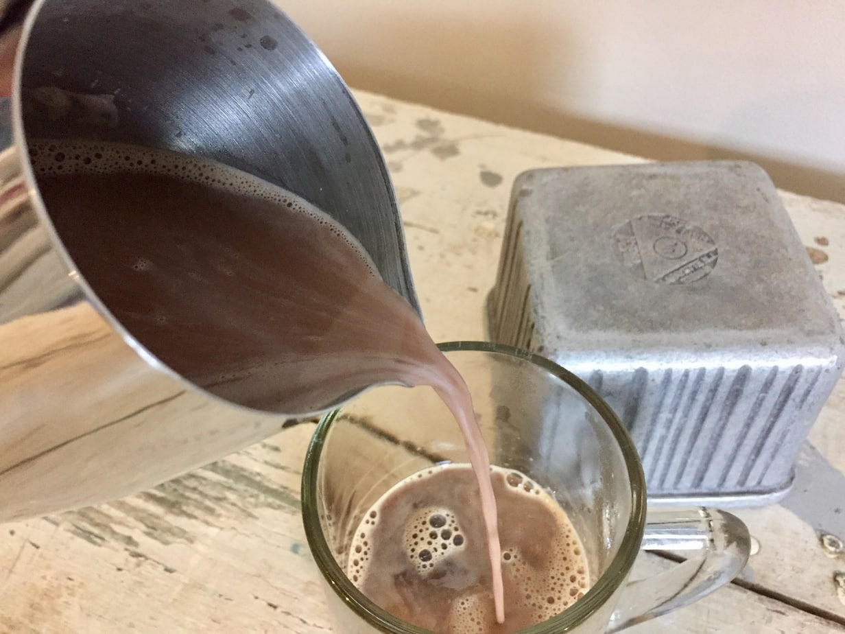 pour hazelnut mix over coffee