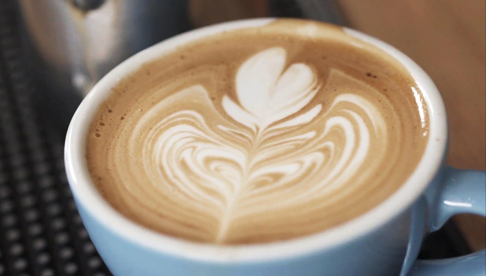 coffee with rosetta latte art