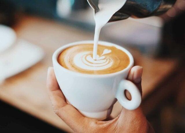 Milk pouring into latte