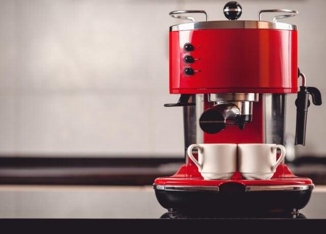 red keurig k-select coffee maker in table